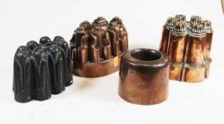 A 19th century Benham & Froud copper jelly mould, the castellated top above a lobed body, height