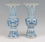 A pair of Chinese export blue & white gu shaped vases having a flared rim to slender neck, square