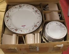 A modern Noritake ivory china eight-place setting dinner service, in the Adagio pattern, No.7237, in