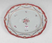 A stoneware meat dish of shaped oval form, enamel decorated with flowers within pink border, width