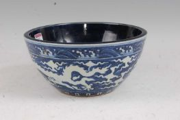 A Chinese export stoneware bowl having a plain blue interior, the exterior decorated with a five
