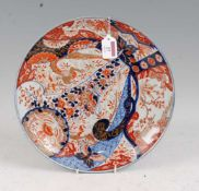 A Japanese late Meiji (1868-1912) period shallow dish, typically decorated in the Imari palette in