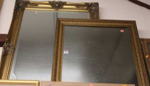 A modern gilt framed and bevelled rectangular wall mirror, 100 x 82cm; and one other smaller example