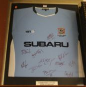 A framed and signed Coventry City football shirt, from the 2004-05 season commemorating their last