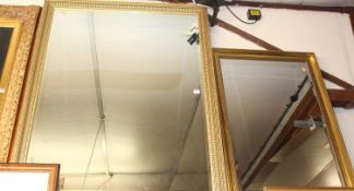 A reproduction gilt framed and bevelled rectangular wall mirror, 126 x 100cm; and one other