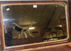 An 18th century walnut and parcel gilt framed wall mirror (some losses), 67 x 42cm