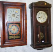 An early 20th century walnut drop trunk wall clock, with pendulum, together with an early 20th