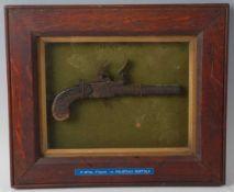 A 19th century flintlock box lock pocket pistol, the lock plate marked London, housed in an oak