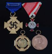 A German Civil Service 40 year Faithful Service medal, together with an Austrian Franz Joseph