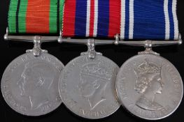 A group of three medals to include WW II Defence, War and E.R. II Police Exemplary Service medal,
