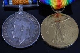 A WW I British War and Victory pair, naming 61645. CPL. A.C. FOWLES. W. YORKS. R. (2)