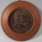 A WW I bronze memorial plaque, naming Jesse Pearson, mounted in an oak surround, dia. 20cm.