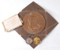 A WW I Casualty group to include a bronze memorial plaque, naming George Fletcher, in envelope