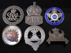 A WW I silver War Badge, numbered verso 216977, together with a silver ARP badge, a silver Cameron