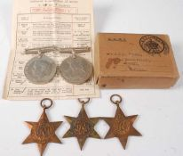 A group of five WW II medals, to include 1939-1945 Star, Africa Star, Burma Star, Defence and War,