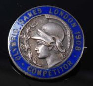 A London 1908 Olympic Games competitors medal in white metal and blue enamel, the pin back