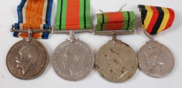 A WW I British War medal, naming 1739 PTE. W. SHAW. R.A.M.C., together with two WW II Defence medals