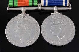 A WW II Defence medal, together with a George VI Exemplary Police Service medal, naming INSPR ARTHUR