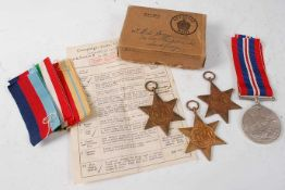 A group of four WW II medals, to include 1939-1945 Star, Italy Star, Africa Star, and War medal,