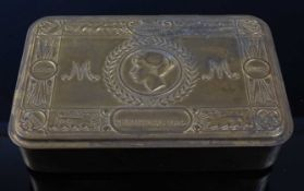 A WW I Princess Mary Christmas gift tin with remains of a parcel of French tobacco with cigarette