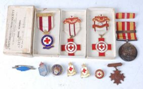 A British Red Cross Society enamelled breast badge, naming 31725 R. Brown, in original box, together