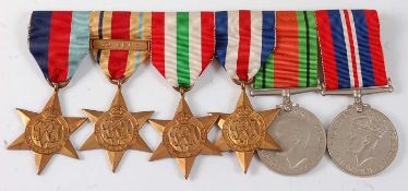 A group of six WW II medals to include 1939-1945 Star, Africa Star with 8th Army clasp, Italy