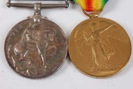 A WW I British War and Victory pair, naming 320764 PTE. B.W. SEELEY. SUFF. R., boxed. (2)