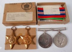 A group of four WW II medals to include 1939-1945 Star, France and Germany Star, Defence and War, in