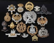 A collection of cap badges and insignia to include London Scottish, Dorsetshire, Suffolk, Essex, R.