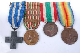 A WW I Italian medal group of four to include War Cross, War Medal with 1916,1917 and 1918 clasps,