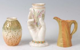 A Worcester porcelain hand-held vase, of conical form, the vase decorated with wildflowers, the hand