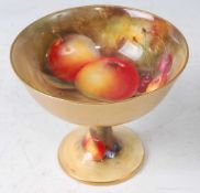 A Royal Worcester pedestal sweetmeat dish, decorated with fruit on a mossy bank by William Bee,