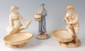 A pair of Royal Worcester figural comports by James Hadley, modelled as a boy and girl seated upon a