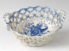 A Lowestoft porcelain chestnut basket, circa 1785, lattice-worked and blue and white printed in