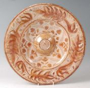 A Hispana Moresque lustre ware charger, Spain, 16/17th century, decorated with flowers and