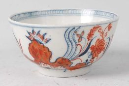 A Lowestoft porcelain tea bowl, decorated in the Tobacco leaf pattern and the Imari palette, dia.7.