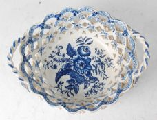 A Lowestoft porcelain chestnut basket, circa 1785, lattice worked and blue and white printed in