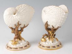 A pair of Royal Worcester porcelain Nautilus shell vases, each on bronzed and gilded moulded