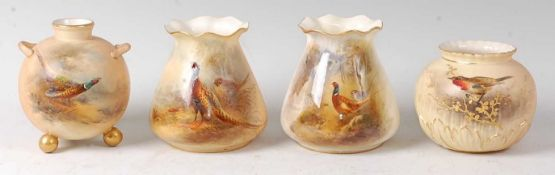 A Royal Worcester globular vase, on three gilded ball feet, decorated by James Stinton with a