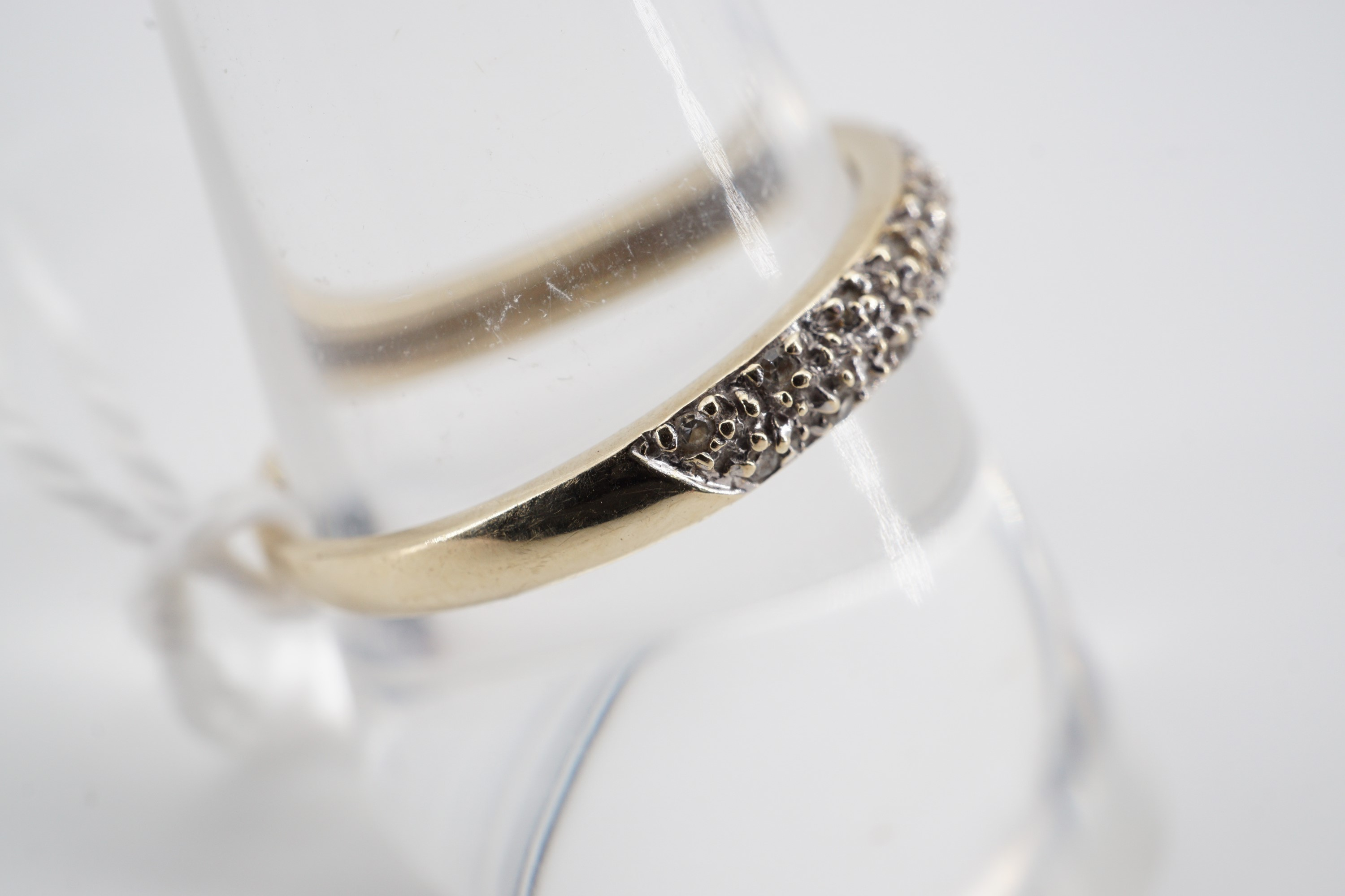 Lot 734 - A contemporary 9ct gold and diamond frosted eternity ring, the face being pellet and illusion-set