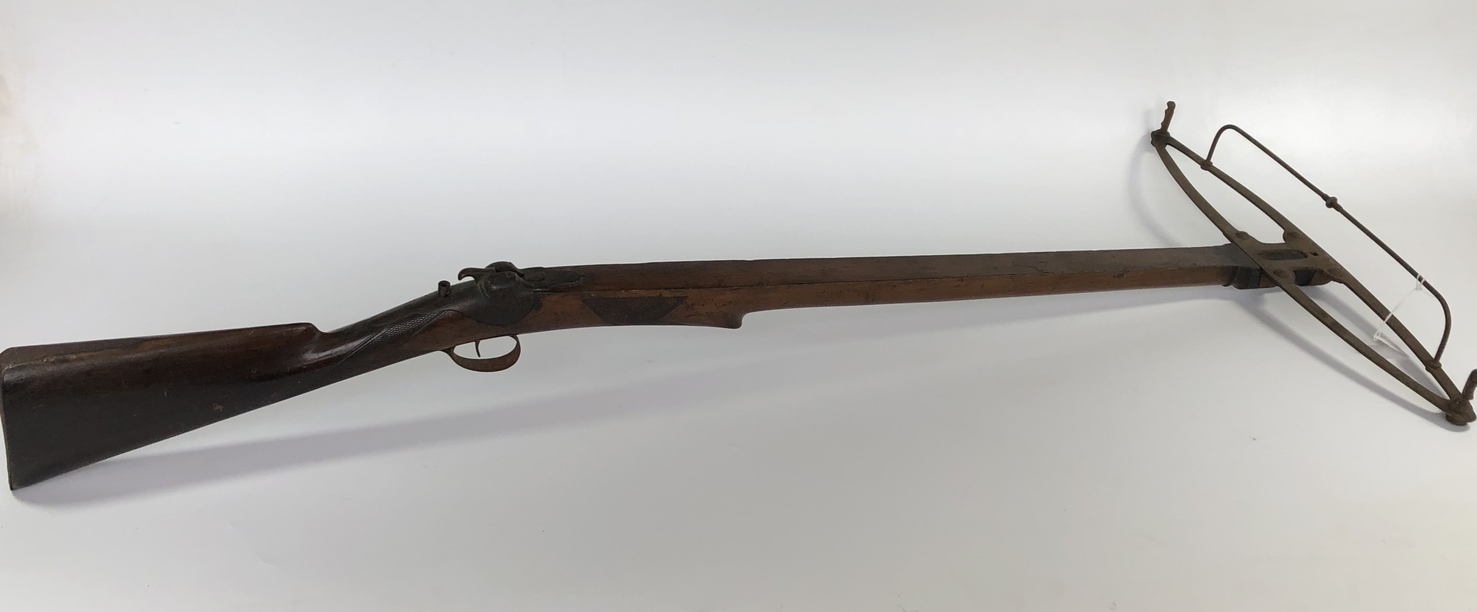 A Hodge`s Patent Elastic Gun, no. 23, circa 1850, having a walnut full stock fitted with rigid steel