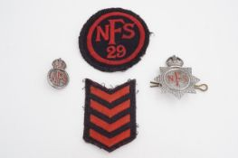 A small group of Second World War Fire Service insignia