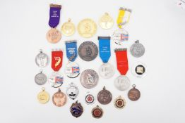 A large number of Muzzle Loader's Association and other firearms marksmanship prize medallions