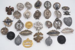 A large quantity of reproduction Imperial and Third Reich German military insignia