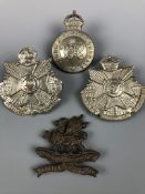 An 11th (Lonsdale) Battalion Officer's Service Dress cap badge together with 4th and 5th Battalion