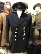 A vintage Merchant Navy uniform and cap