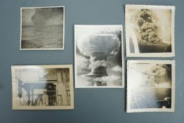Period unofficial photographs of the sinking of the tanker Empire Gold following shelling by the