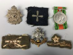 A Defense Medal, cap badges and cloth insignia