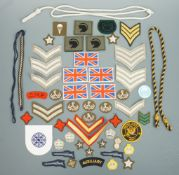 Sundry items of military cloth insignia and lanyards