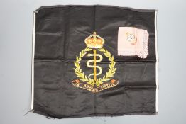 A Royal Army Medical Corps embroidery together with an RAF embroidered doily